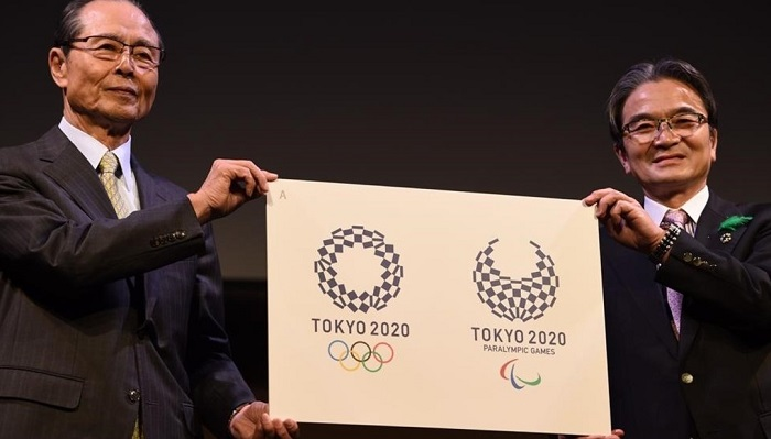 Ryohei Miyata  Tokyo 2020 emblems selection committee chairperson  R  and committee member and former baseball star Sadaharu Oh  L  present the newly-selected Tokyo 2020 logo during an unveiling ceremony in Tokyo on April 25  2016  Tokyo 2020 Olympic organisers on April 25 announced a new logo more than six months after the original choice was scrapped over an embarrassing plagiarism scandal    AFP PHOTO   TOSHIFUMI KITAMURA